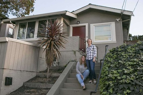 Lyndsey and Sharon Ballinger in front of their Oakland home. - PHOTO COURTESY OF THE PACIFIC LEGAL FOUNDATION
