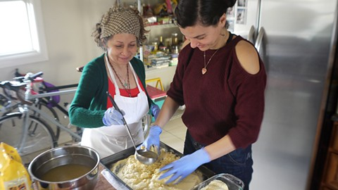 Maria Leon (right) made hallacas in Oakland when her mom visited from Venezuela. - PHOTO COURTESY OF MARIA LEON
