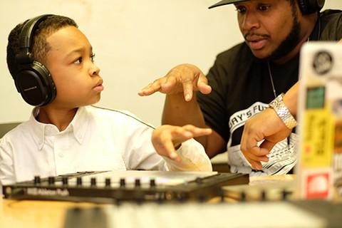 Marlon Richardson (right) works with students through the nonprofit. - PHOTO COURTESY OF BRIAN DESIMONE
