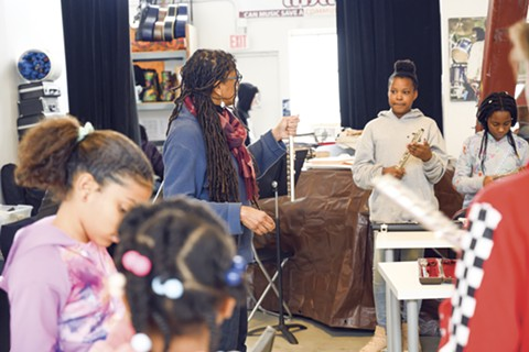 Nzingah Smith, Teaching Artist for the Black Girls Play flute class, works with a group of students. - PHOTO BY LANCE YAMAMOTO