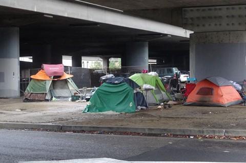 Homeless camp under Interstate 880 in Oakland. - DARWIN BONDGRAHAM