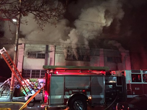 Firefighters putting out the Ghost Ship warehouse fire in Oakland in December 2016. - SEUNG LEE