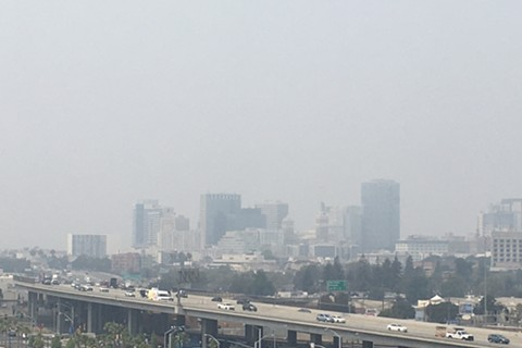Smoke lingering over downtown Oakland on Monday and blotting out the entire San Francisco skyline - STEVEN TAVARES