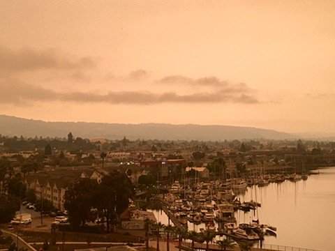 Oakland Estuary and East Bay Hills bathed in an orange glow on Wednesday afternoon. - STEVEN TAVARES