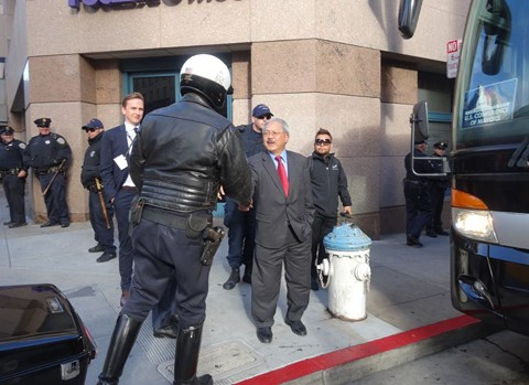 San Francisco Mayor Ed Lee shakes hands with an SFPD officer. - DARWIN BONDGRAHAM