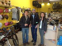 Laurel Cyclery owner Jason Wallach (center).