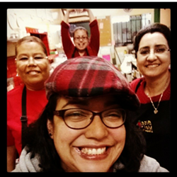 """Tina """"Tamale"""" Ramos (front-center) with the La Borinqueña staff. - LA BORINQUEÑA"""