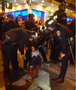 Oakland police officers use force while making an arrest at a demonstration on May 24. - DARWIN BONDGRAHAM