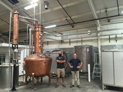 Daniel Wright (left) and Earl Brown in their West Oakland facility. - SARA HARE