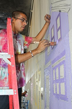 Antonio Ramos working on the West Oakland mural. - AHC-OAKLAND.ORG