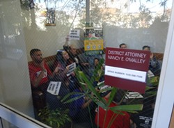 Union leaders staged a sit-in inside DA O'Malley's office demanding she drop charges against the Black Friday 14. - DARWIN BONDGRAHAM