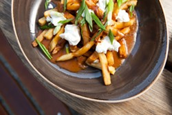 This fairly traditional version of poutine has some surprising elements. - BERT JOHNSON