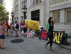 Opponents of coal gather outside of Oakland City Hall in September. - DARWIN BONDGRAHAM