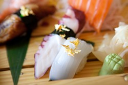 The nigiri & sashimi combo is available with optional edible gold flakes. - BERT JOHNSON