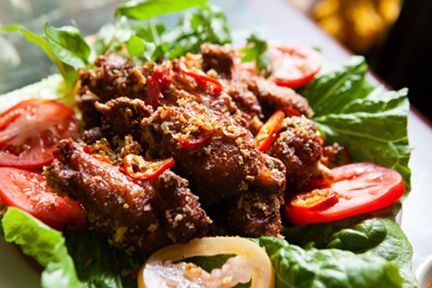 The fried chicken wings were seasoned simply with salt and pepper, with just a hint of chili heat. - BERT JOHNSON