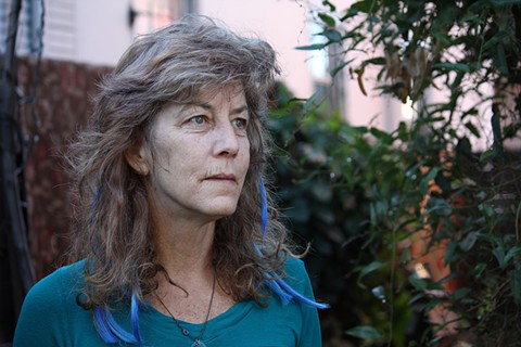 Unlike many Oakland landlords, Elizabeth Dougherty wants to keep her tenants' rent below market rate. - LUCAS WALDRON