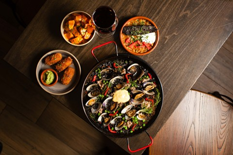 Clockwise from left: patatas bravas, mushroom croquetas, morcilla, and arroz negro.