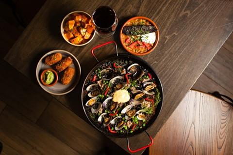 Clockwise from left: patatas bravas, mushroom croquetas, morcilla, and arroz negro.