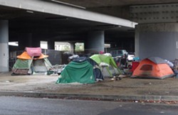 A homeless camp under the 880 Freeway in downtown Oakland. - DARWIN BONDGRAHAM