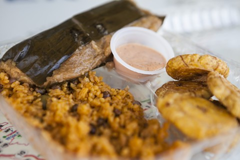 Pork pastel, tostones, and arroz con gandules, with a side of the house mayuketchu. - ERIN BALDASSARI