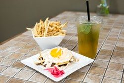 Steak & eggs taco, fries, and iced tea at Belly. - BERT JOHNSON
