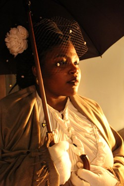 Rolanda Dene as the ghost of Ida B. Wells. - COURTESY UBUNTU