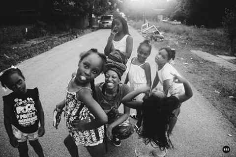 Sensabaugh (C)  with neighborhood kids. - BRITTANI SENSABAUGH