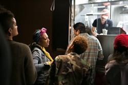 An evening event at Tacos Sinaloa in East Oakland. - BERT JOHNSON