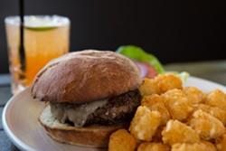 The burger and tater tots at Handlebar. - BERT JOHNSON/FILE PHOTO