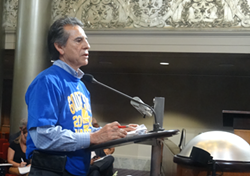 Councilmember Noel Gallo speaking about the police commission ballot measure he co-authored with Councilmember Dan Kalb at yesterday's Rules and Legislation Committee meeting. - DARWIN BONDGRAHAM