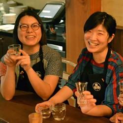 Umami Mart co-owners Kayoko Akabori and Yoko Kumano enjoy some sake.