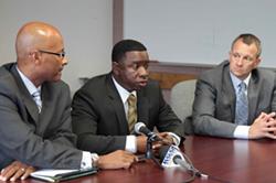 OPD Sergeant Mike Gantt (center) in 2011. - ALI WINSTON
