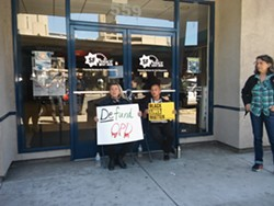 Protesters locked themselves to the doors of the Oakland police union building.