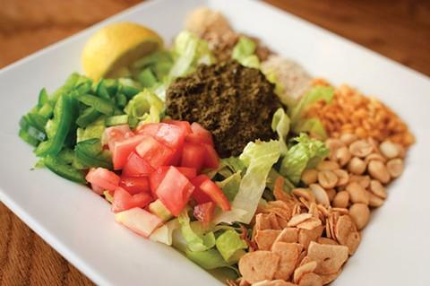 The Bay Area's best-known purveyor of Burmese tea leaf salad faces a major lawsuit. - CHRIS DUFFEY/FILE