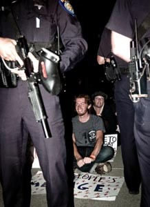 Sean Thompson, center, shown at an Occupy Sacramento protest in 2011. He was arrested multiple times during these actions at Cesar Chavez Plaza. - PHOTO BY DON BUTTON