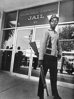 Bobby Hutton in front of the Oakland Police Department.