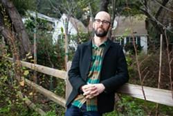 Josh Harkinson and his fence in March. - BERT JOHNSON
