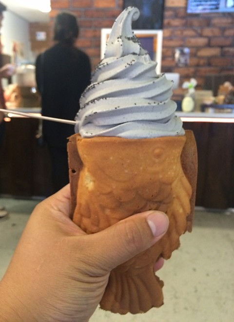 You will have to wait on line to snag one of Uji Time's fish cones — pictured here with black sesame soft-serve ice cream. - LUKE TSAI