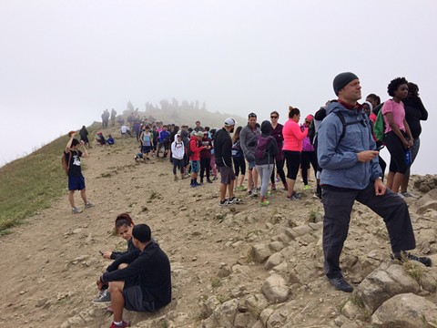 Hikers line up to take photos and selfies at the ever popular Mission Peak Regional Preserve summit in Fremont. - PHOTO COURTESY OF MIGUEL VIEIRA/FLICKR