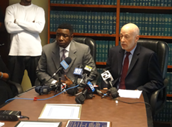 Oakland Police Sergeant James Gantt with his attorney Dan Siegel at a press conference today in Oakland. - DARWIN BONDGRAHAM