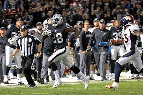 Latavius Murray owned the ground game, hustling for 114 yards and three touchdowns during last night's primetime smackdown of the champion Denver Broncos. - PHOTO COURTESY OF THE RAIDERS