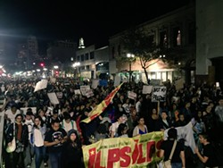 More than 12,000 activists marched through Oakland the evening of November 9. - NICK MILLER