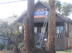 After it was stolen, Gorelik had workers move his Trump sign to the house, adding lights and barbed wire.