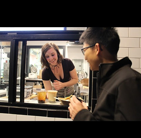 Natty Cake's Natalie Pearce serves a customer. - HAILEY ZHOU