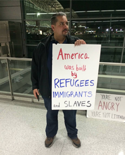 Oakland Councilmember Abel Guillen opposing Trump's immigration order over the weekend. - FACEBOOK