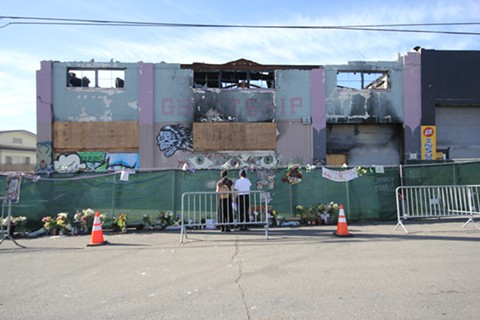 Two individuals visit the Ghost Ship site this past Friday. - BY DAMU DAILEY