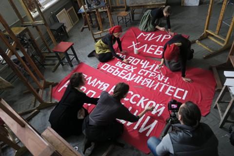 Demonstrators prepare for a rally in Revolution.
