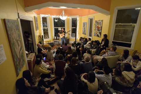 A very attentive audience at a recent Sofar Sounds show inside a South Berkeley home. - GEORGE BAKER