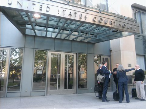 Michael Marr (right) and his attorneys outside Oakland's federal courthouse this afternoon.