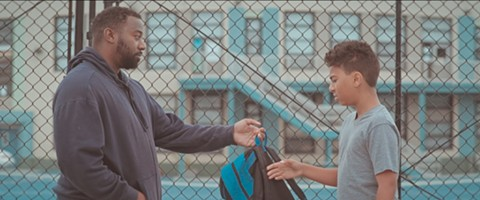 """A still from Jehnovah Carlisle's Day by Day, featuring Carvell Wallace (""""Michael"""") and Ezra Wallace (""""Johnny"""") from left to right."""